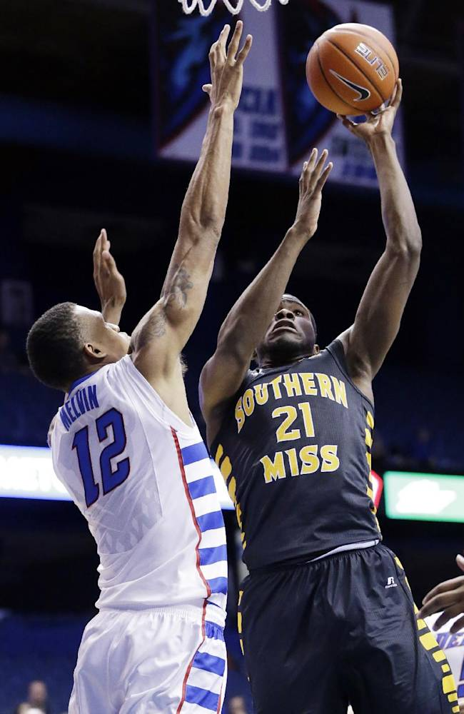 Southern Mississippi forward Norville Carey, right, goes up for a shot against DePaul forward Cleveland Melvin during the first half of an NCAA college basketball game in Rosemont, Ill., Wednesday, Nov. 13, 2013