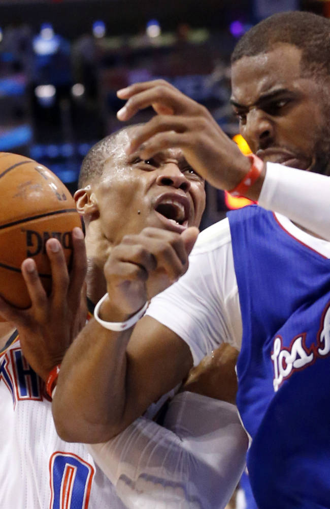 Oklahoma City Thunder guard Russell Westbrook (0) drives against Los Angeles Clippers guard Chris Paul (3) in the fourth quarter of Game 5 of the Western Conference semifinal NBA basketball playoff series in Oklahoma City, Tuesday, May 13, 2014. Oklahoma City won 105-104. (AP Photo)