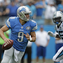 Detroit Lions quarterback Matthew Stafford (9) scrambles as Carolina Panthers' Charles Johnson (95) pursues during the first half of an NFL football game in Charlotte, N.C., Sunday, Sept. 14, 2014 The Associated Press