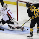 Washington Capitals goaltender Philipp Grubauer (31), of Germany, makes a save on Buffalo Sabres left winger Matt Moulson (26) during the third period of an NHL hockey preseason game, Wednesday, Oct., 1, 2014, in Buffalo, N.Y. Buffalo won 6-1 The Associat