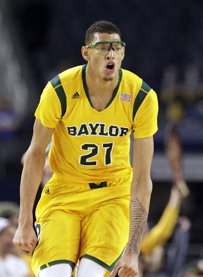 Baylor center Isaiah Austin (21) celebrates after dunking against Kentucky in the second half of an NCAA college basketball game, Saturday, Dec. 7, 2013, in Arlington, Texas. Baylor upset Kentucky 67-62