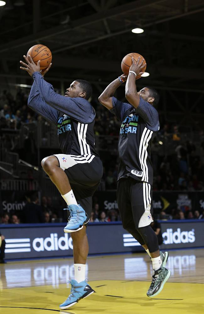 East Team's Joe Johnson, of the Brooklyn Nets, right, and Kyrie Irving, of the Cleveland Cavaliers, both go to the basket during basketball practice at the NBA All-Star game in New Orleans, Saturday, Feb. 15, 2014