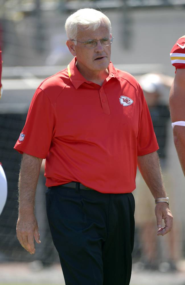 In this Sept. 8, 2013, file photo, Kansas City Chiefs defensive coordinator Bob Sutton watches during warm ups prior to an NFL football game against the Jacksonville Jaguars in Jacksonville, Fla. Nobody would think the mild-mannered, bespectacled gentleman is actually a mad scientist pulling the strings on the Kansas City Chiefs defense