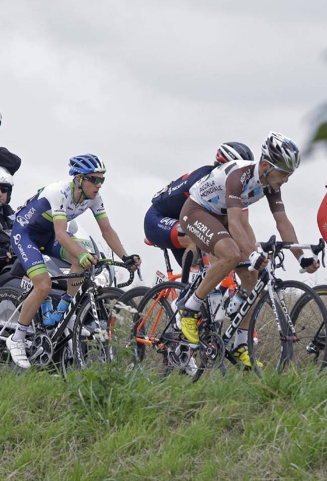 The breakaway with stage winner France's Blel Kadri, second right, Netherland's Niki Terpstra, left, Britain's Simon Yates, second left, France's Sylvain Chavanel, third left hidden, and France's Adrien Petit, right, ride during the eighth stage of the Tour de France cycling race over 161 kilometers (100 miles) with start in Tomblaine and finish in Gerardmer, France, Saturday, July 12, 2014