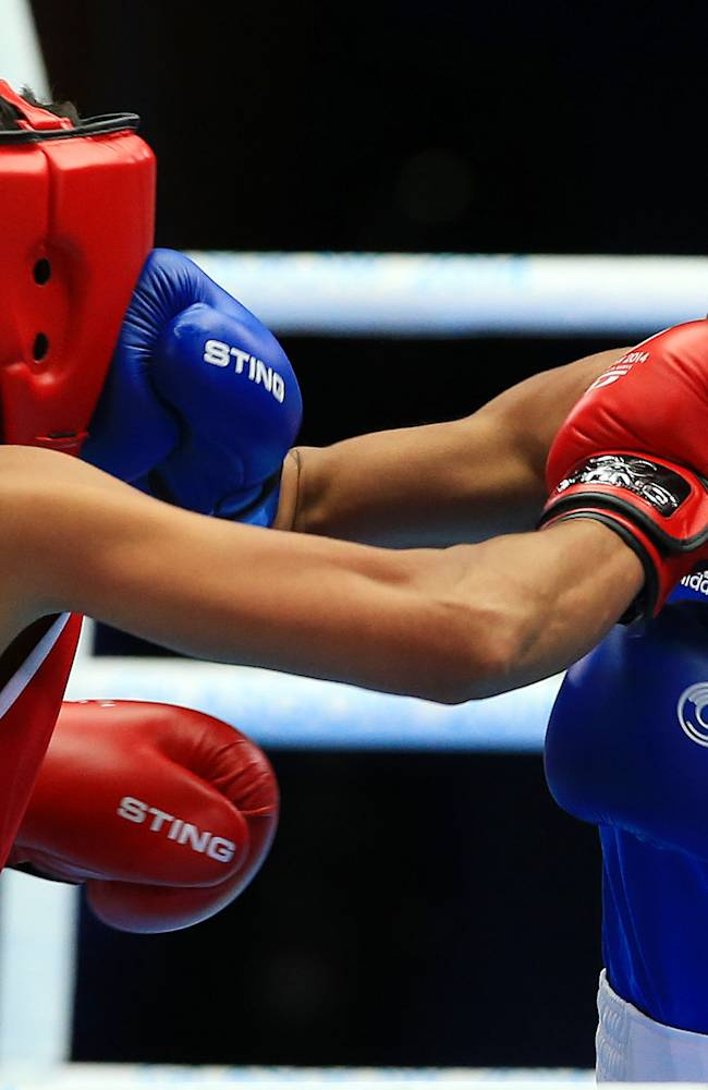 New Zealand's Alexis Pritchard, left, competes with Dominica's Valerian Spicerin in the women's light 57-60Kg weight at the SECC, during the 2014 Commonwealth Games in Glasgow, Scotland, Tuesday, July 29, 2014