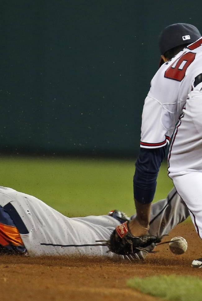 Houston Astros' George Springer steals second base as Atlanta Braves shortstop Elmer Reyes loses the ball, in the ninth inning of an exhibition baseball game, Friday, Feb. 28, 2014, in Kissimmee, Fla
