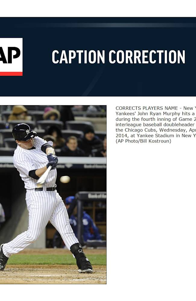 CORRECTS PLAYERS NAME - New York Yankees' John Ryan Murphy hits a single during the fourth inning of Game 2 of an interleague baseball doubleheader against the Chicago Cubs, Wednesday, April 16, 2014, at Yankee Stadium in New York