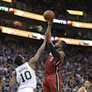 Miami Heat's Dwyane Wade (3) shoots as Utah Jazz's Alec Burks (10) defends during the second quarter of an NBA basketball game Saturday, Feb. 8, 2014, in Salt Lake City The Associated Press