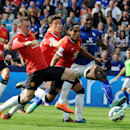 Manchester United's Wayne Rooney, left, Ander Herrera, center, and Radamel Falcao, second right, attempt a shot at goal watched by Leicester's Wes Morgan, right, during the English Premier League soccer match between Leicester City and Manchester United a