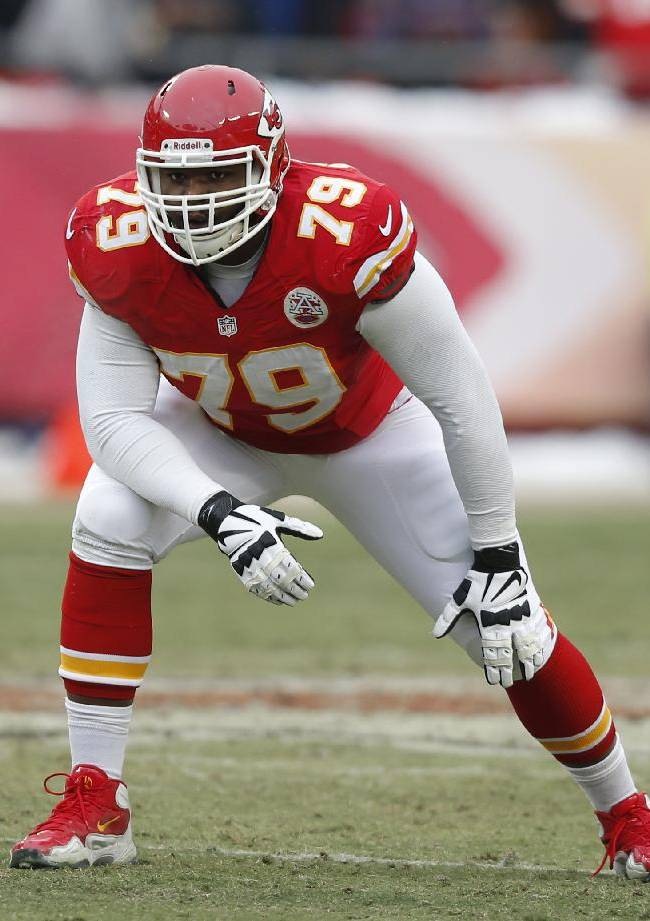 In this Dec. 22, 2013, file photo, Kansas City Chiefs tackle Donald Stephenson (79) waits for a play to start during the second half of an NFL football game against the Indianapolis Colts at Arrowhead Stadium in Kansas City, Mo. There's hardly an NFL offseason anymore, but dozens of players are taking it to an extreme, choosing to hit one of several NFL academies rather than head to the beach of visit home during their rare weeks off