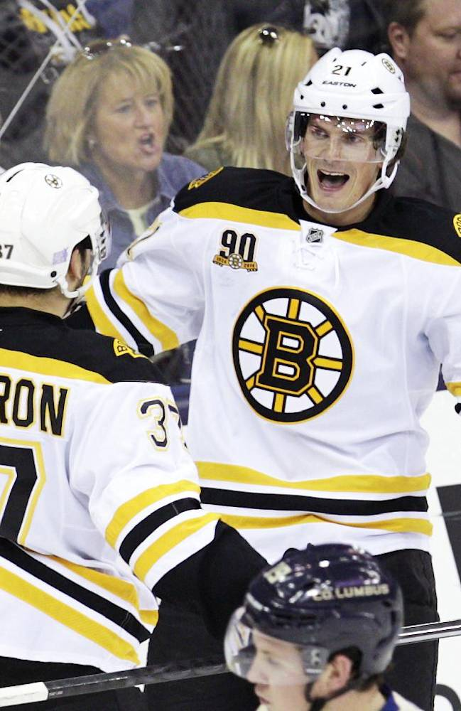 Boston Bruins' Loui Eriksson, right, of Sweden, celebrates his goal against the Columbus Blue Jackets with teammate Patrice Bergeron during the third period of an NHL hockey game Saturday, Oct. 12, 2013, in Columbus, Ohio. The Bruins beat the Blue Jackets 3-1