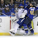 St. Louis Blues' Brenden Morrow (10) collides with Tampa Bay Lightning goalie Ben Bishop (30) during the second period of an NHL hockey game, Tuesday, March 4, 2014 in St. Louis The Associated Press