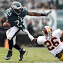 Philadelphia Eagles' LeSean McCoy (25)is dragged to the turf by Washington Redskins cornerback Josh Wilson during the first half of an NFL football game in Philadelphia, Sunday, Nov. 17, 2013 The Associated Press