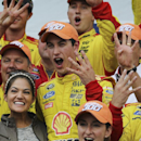 Driver Joey Logano celebrates, after winning his fourth win of the season, in Victory Lane after winning the Sylvania 300 at New Hampshire Motor Speedway, Loudon, N.H., Sunday, Sept. 21, 2014 (AP Photo/Cheryl Senter)
