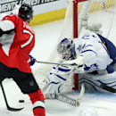 Toronto Maple Leafs goaltender James Reimer (34) attempts to reach the puck as Ottawa Senators Kyle Turris (7) looks on during third period NHL hockey in Ottawa, Ontario, Sunday, Nov. 9, 2014 The Associated Press