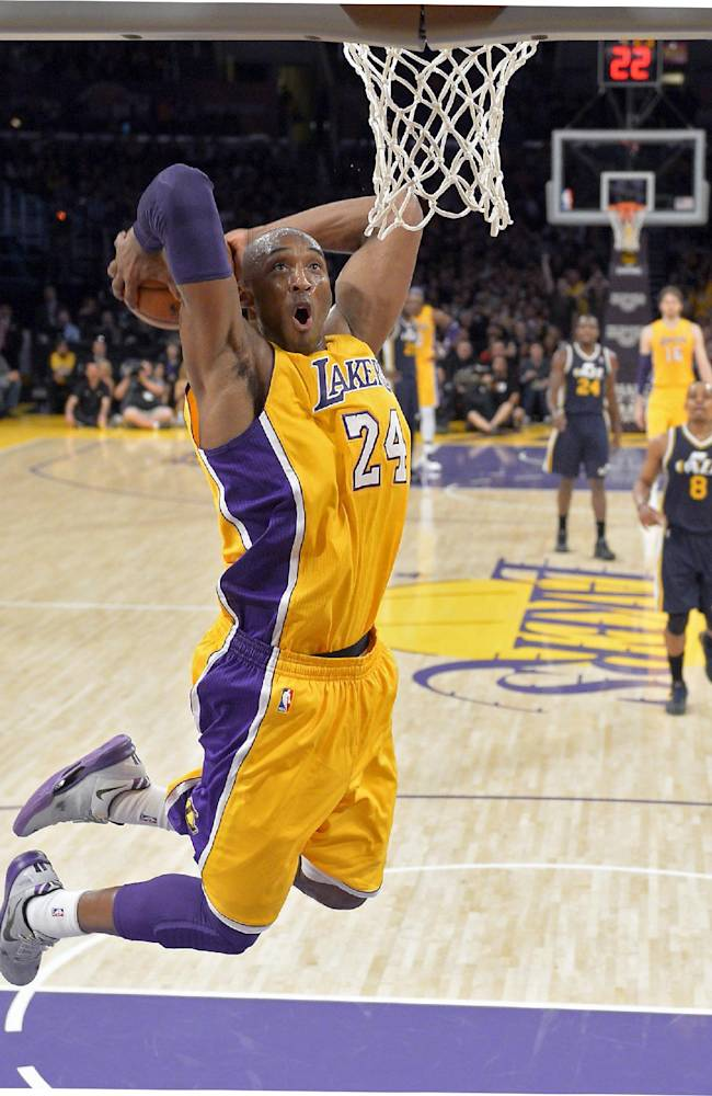 In this Jan. 25, 2013 file photo, Los Angeles Lakers guard Kobe Bryant goes up for a dunk during the first half of an NBA basketball game against the Utah Jazz, in Los Angeles. The Lakers have signed Bryant to a 2-year contract extension. General manager Mitch Kupchak made the announcement Monday, Nov. 25, 2013, ending speculation that Bryant could end up with another team after this season