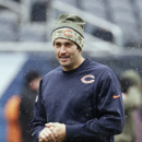 Snow comes down as Chicago Bears quarterback Jay Cutler warms up before an NFL football game against the Minnesota Vikings Sunday, Nov. 16, 2014, in Chicago The Associated Press
