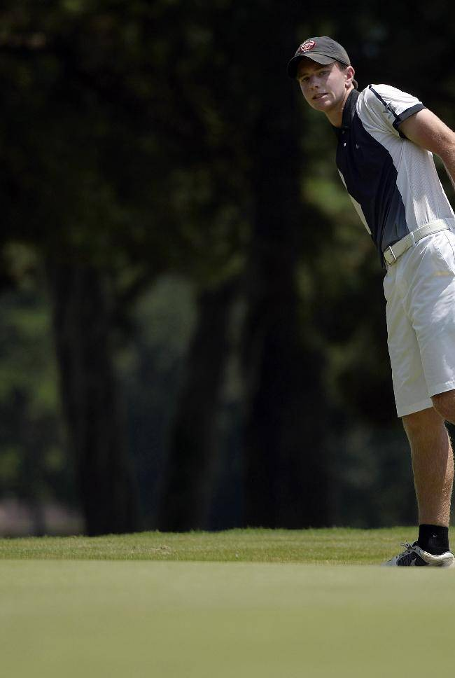 Joey Lane, of Great Falls, Va., watches his putt miss the hole on the fourth green during the second day of the Oglethorpe Invitational at Wilmington Island Club in Savannah, Ga., on Friday, July 25, 2014