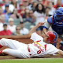 St. Louis Cardinals' Peter Bourjos (8) scores on a sacrifice fly by Matt Carpenter as Chicago Cubs' Welington Castillo, right, can't make the tag in the fourth inning in a baseball game, Sunday, April 13, 2014, in St. Louis The Associated Press