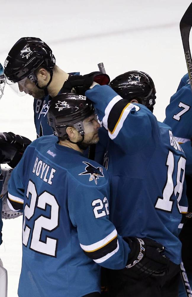 The San Jose Sharks celebrate a 3-2 shootout win over the Los Angeles Kings in an NHL hockey game Wednesday, Nov. 27, 2013, in San Jose, Calif