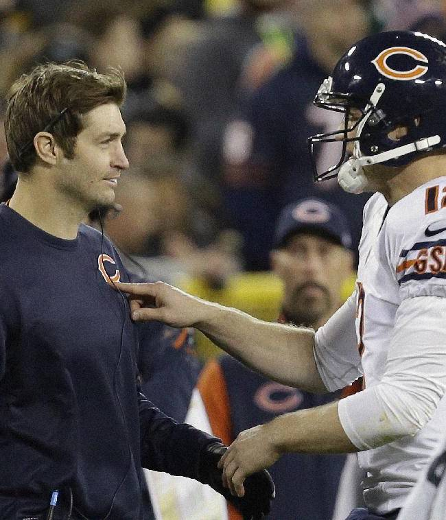 Chicago Bears quarterback Josh McCown (12) talks to Jay Cutler during the first half of an NFL football game against the Green Bay Packers Monday, Nov. 4, 2013, in Green Bay, Wis