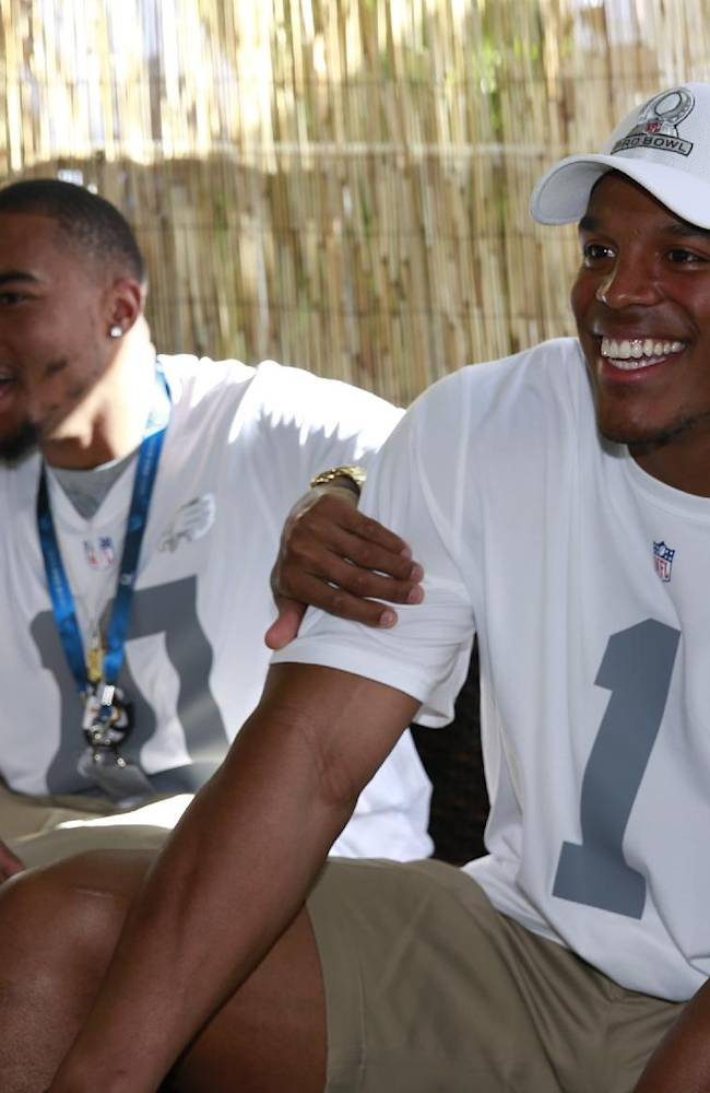 CORRECTS SPELLING OF JACKSON'S FIRST NAME - Philadelphia Eagles wide receiver DeSean Jackson (10) jokes around with Carolina Panthers quarterback Cam Newton (1) in the green room at the NFL Pro Bowl football draft, Wednesday, Jan. 22, 2014, in Kapolei, Hawaii
