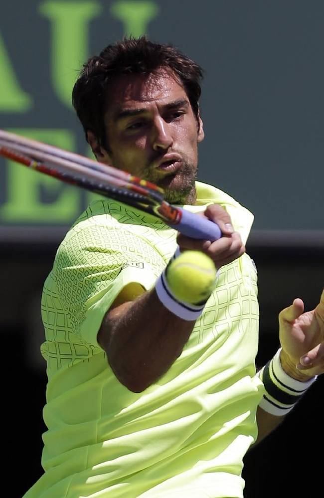 Jeremy Chardy, of France, returns to Juan Monaco, of Argentina, during the first round at the Sony Open tennis tournament at Key Biscayne, Fla., Wednesday, March 19, 2014