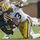 LSU wide receiver Odell Beckham Jr. (3) is stopped by Auburn linebacker Jonathan Evans (35) in the first half of an NCAA college football game Saturday, Sept. 22, 2012 at Jordan-Hare Stadium in Auburn, Ala. (AP Photo/Dave Martin)