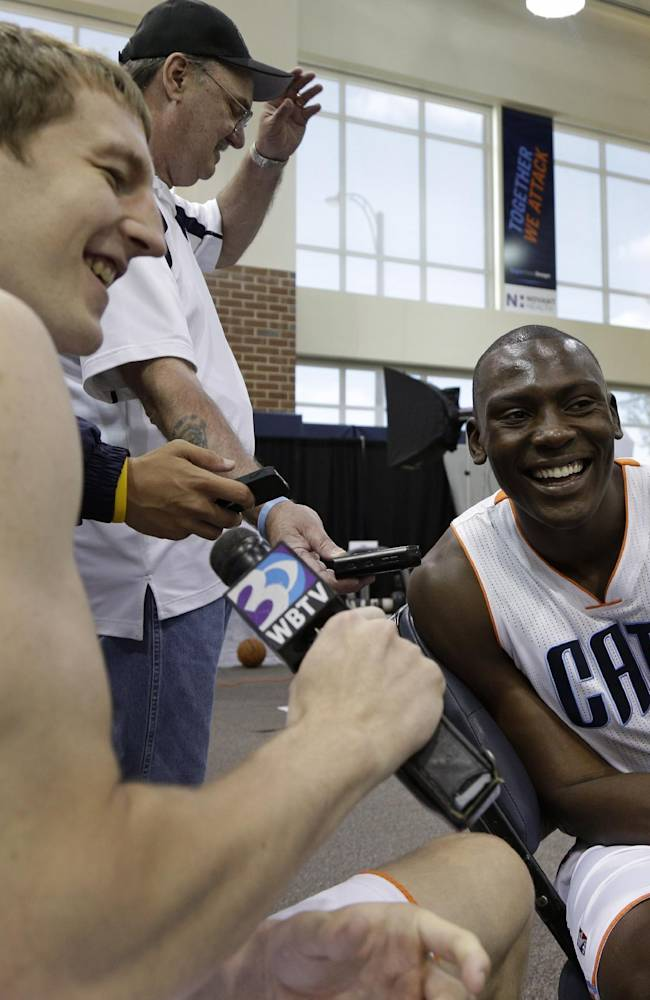 Charlotte Bobcats' Cody Zeller, left, interviews Bismack Biyombo, right, during the NBA basketball team's media day in Charlotte, N.C., Monday, Sept. 30, 2013