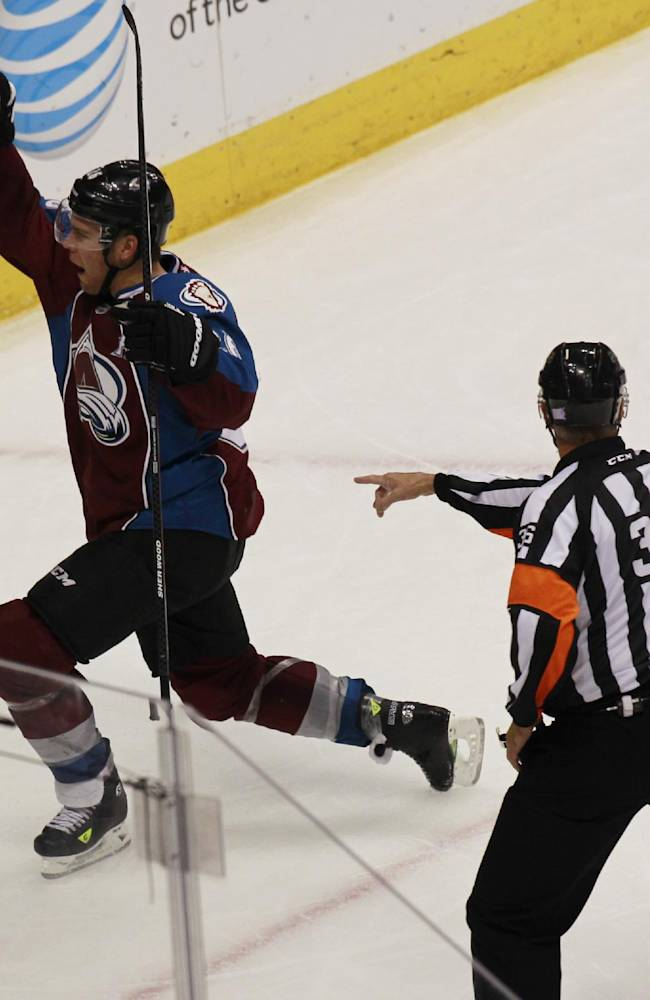 Colorado Avalanche center Paul Stastny, left, celebrates scoring the go-ahead goal as referee Dean Morton looks on against the Winnipeg Jets in the third period of the Avalanche's 3-2 victory in an NHL hockey game in Denver on Sunday, Oct. 27, 2013