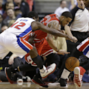 Detroit Pistons guard Will Bynum (12) and Chicago Bulls guard D.J. Augustin (14) chase a loose ball during the second half of an NBA basketball game in Auburn Hills, Mich., Wednesday, March 5, 2014. Augustin scored 26 points off the bench as the Bulls bea