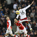 Arsenal's Santi Cazorla, below, vies for the ball with Aston Villa's Fabian Delph during the English Premier League soccer match between Arsenal and Aston Villa at the Emirates stadium in London, Sunday, Feb. 1, 2015