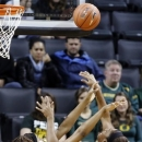 Connecticut forward MorganTuck, right, shoots against Oregon forward Jillian Alleyne during the first half of an NCAA college basketball game in Eugene, Ore., Monday, Dec. 31, 2012. (AP Photo/Don Ryan)