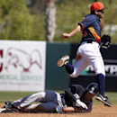 Houston Astros second baseman Jose Altuve (27) leaps over New York Yankees' Dean Anna (93) after getting the force out at second and making the throw to first base to complete the double play in the third inning of a spring exhibition baseball game, Satur