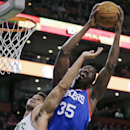 Philadelphia 76ers center Henry Sims (35) hauls down a rebound over Boston Celtics center Kris Humphries, left, during the first quarter of an NBA basketball game Friday, April 4, 2014, in Boston The Associated Press