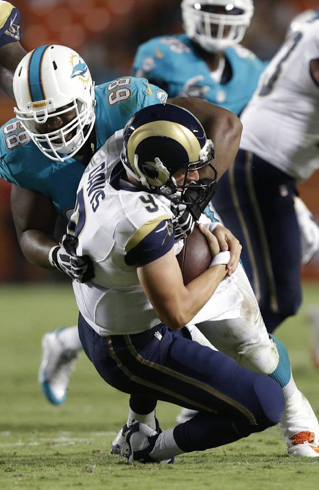 St. Louis Rams quarterback Austin Davis (9) is sacked by Miami Dolphins defensive tackle Garrison Smith (68) during the first half of an NFL preseason football game, Thursday, Aug. 28, 2014 in Miami Gardens, Fla