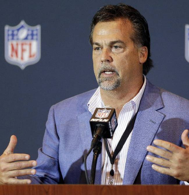 Jeff Fisher, head coach of the St. Louis Rams and member of the NFL competition committee, speaks during a news conference at the NFL football annual meeting in Orlando, Fla., Monday, March 24, 2014