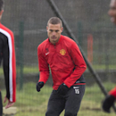 Manchester United's Nemanja Vidic trains with teammates at Carrington training ground in Manchester, Tuesday, March 18, 2014. Manchester United will play Olympiakos in a Champions League last 16 second leg soccer match on Wednesday