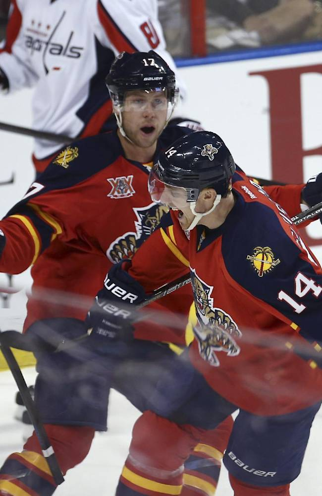 Florida Panthers' Jesse Winchester (17) celebrates with Tomas Fleischmann (14) after Fleischmann scored against the Washington Capitals during the first period of an NHL hockey game, Thursday, Feb. 27, 2014, in Sunrise, Fla
