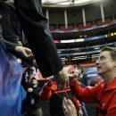Louisville head coach Rick Pitino greets fans after practice for their NCAA Final Four tournament college basketball semifinal game against Wichita State, Friday, April 5, 2013, in Atlanta. Louisville plays Wichita State in a semifinal game on Saturday. (AP Photo/John Bazemore)