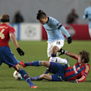 CSKA's Mario Fernandes, right on ground, takes the ball off Manchester City's Sergio Aguero, during the Champions League Group E soccer match between CSKA Moscow and Manchester City at Arena Khimki stadium in Moscow, Russia, Tuesday Oct. 21, 2014