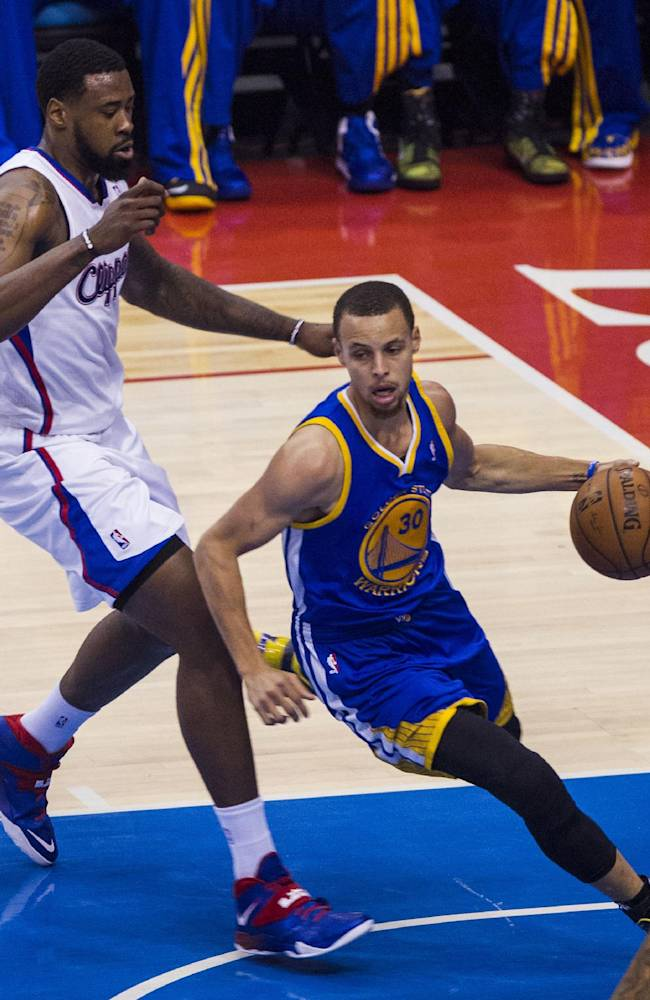 Golden State Warriors guard Stephen Curry (30) drives past Los Angeles Clippers center DeAndre Jordan (6) during the first quarter of Game 7 of a first-round NBA basketball playoff series, Saturday, May 3, 2014, in Los Angeles