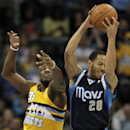 Denver Nuggets power forward Kenneth Faried (35) swats at the ball controlled by Dallas Mavericks point guard Devin Harris (20) in the first quarter of an NBA game in Denver on Wednesday, March 5, 2014 The Associated Press
