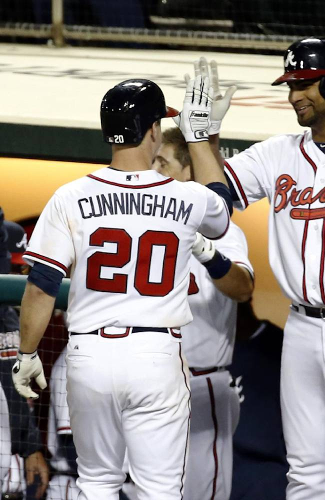 Atlanta Braves' Todd Cunningham (20) celebrates his solo home run with Ernesto Mejia, right, in the eighth inning of an exhibition baseball game against the Houston Astros, Friday, Feb. 28, 2014, in Kissimmee, Fla. The Astros won 7-5