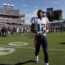 Tennessee Titans quarterback Charlie Whitehurst walks off the field after the fourth quarter of an NFL football game, Sunday, Oct. 5, 2014, in Nashville, Tenn. The touchdown and the extra point gave the Browns a 29-28 win The Associated Press