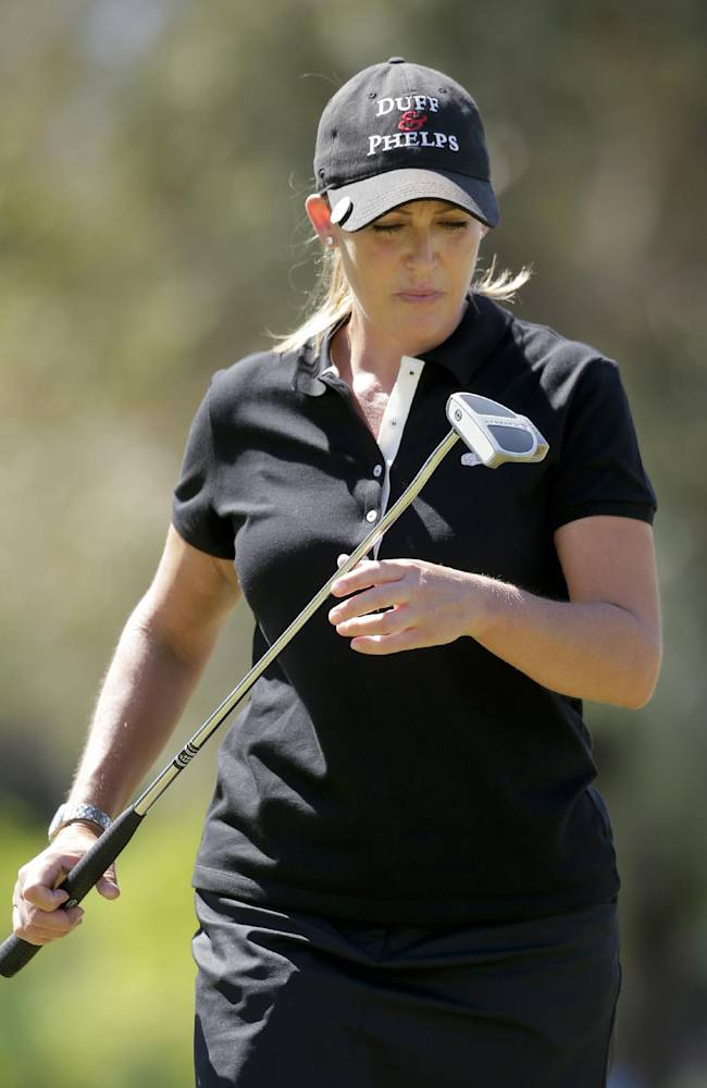 Cristie Kerr looks at her putter after missing a birdie putt on the fourth hole during the final round of the Kraft Nabisco Championship golf tournament Sunday, April 6, 2014 in Rancho Mirage, Calif