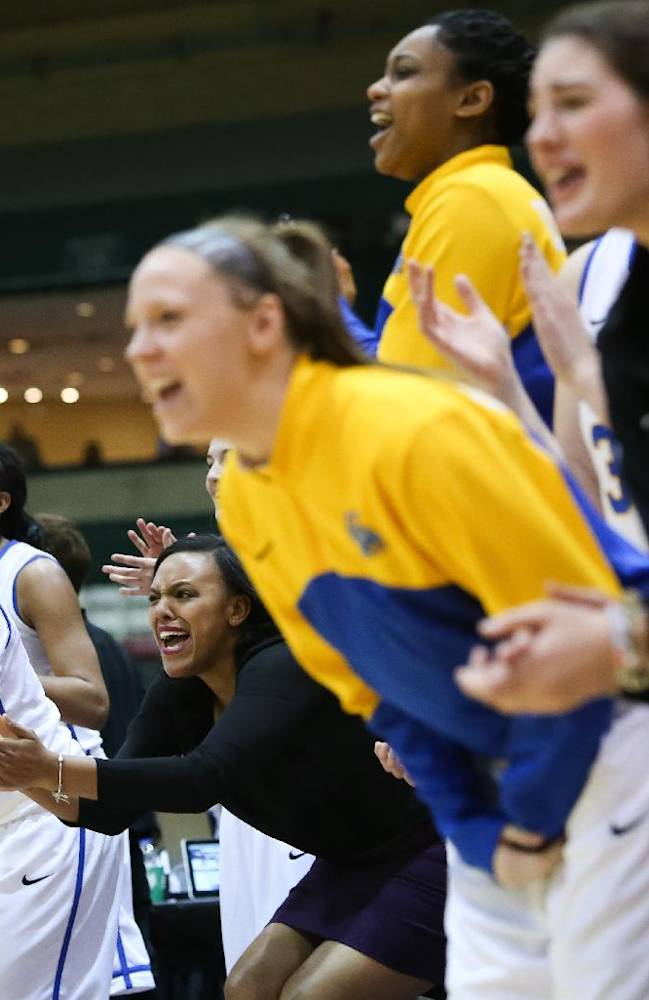 Delaware players celebrate on the sideline during an NCAA college basketball game against Northeastern in the Colonial Athletic Association tournament at the Show Place Arena in Upper Marlboro, Md., Friday, March 14, 2014