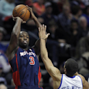 Detroit Pistons guard Rodney Stuckey (3) shoots against Philadelphia 76ers guard Michael Carter-Williams (1) during the second half of an NBA basketball game on 2Sunday, Dec. 1, 2013, in Auburn Hills, Mich. Stuckey scored 17 points in a 115-100 win over t