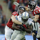 Detroit Lions running back Joique Bell (35) is tackled by Atlanta Falcons outside linebacker Kroy Biermann (71) in the second half of the NFL football game at Wembley Stadium, London, Sunday, Oct. 26, 2014 The Associated Press