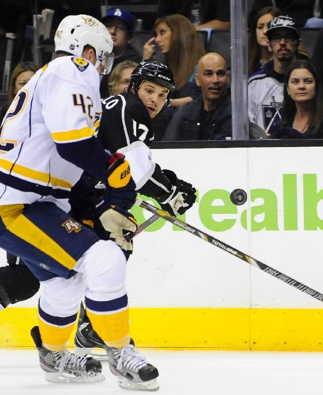 Nashville Predators defenseman Mattias Ekholm (42), of Sweden, and Los Angeles Kings left wing Daniel Carcillo (17) fight for the puck during the second period of their NHL hockey game on Saturday, Nov. 2, 2013, in Los Angeles